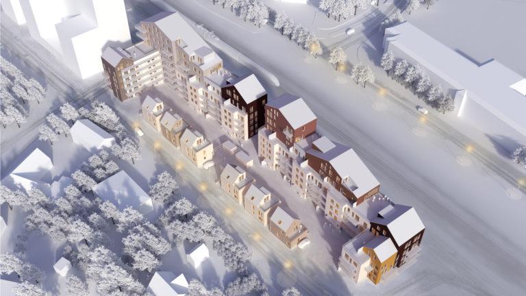 Flygby över område med lägenhetshus på vintern