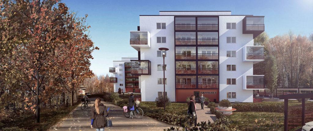 Vitt hus med stora fönster och balkonger