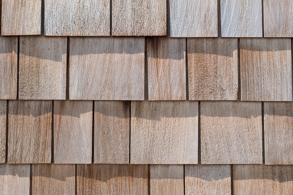 Närbild fasad - Cederträspån