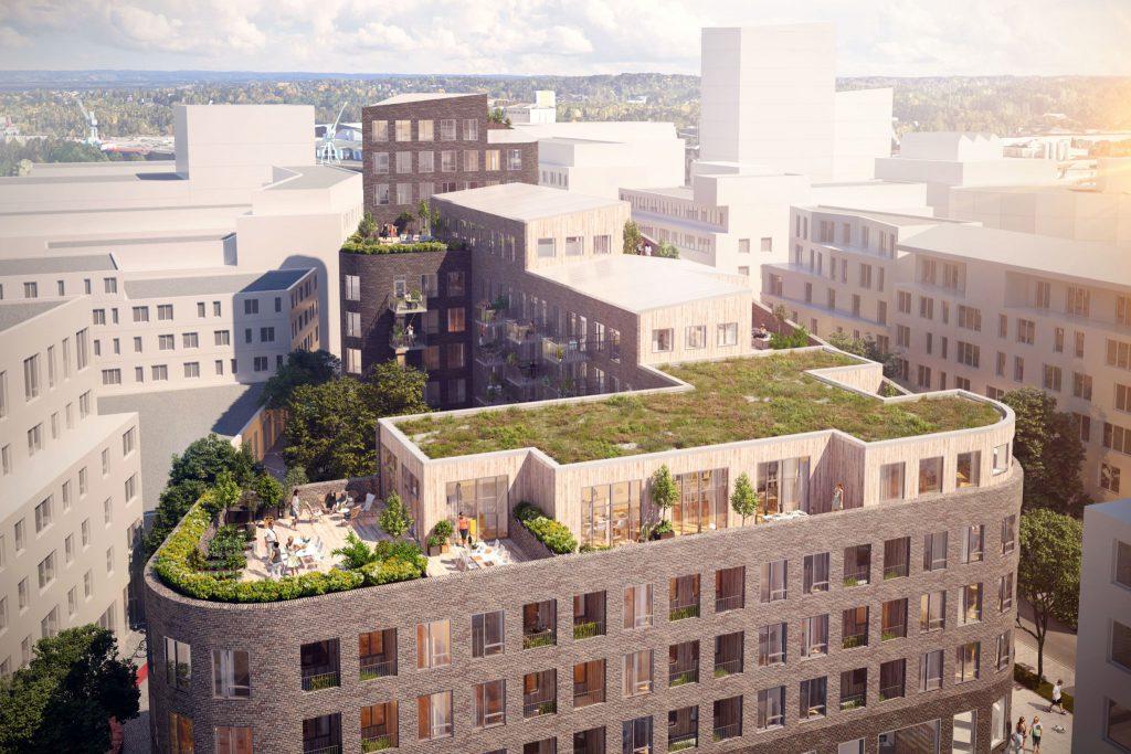 Flygvy på byggnad med grönska på taket