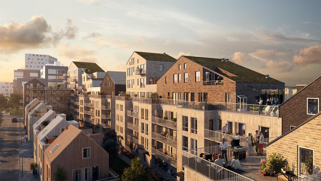 Område med lägenhetshus och mindre hus med terrasser.